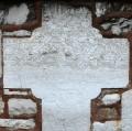 Croix de Jacques le maçon dans le mur d'enceinte de l'église
