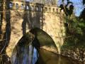 Le Pont Neuf vu de la rive de l'Odon