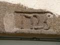 Maison des Pompes : Détail du linteau de porte
