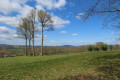 vallée de la Sarthe et, au fond, la butte Chaumont